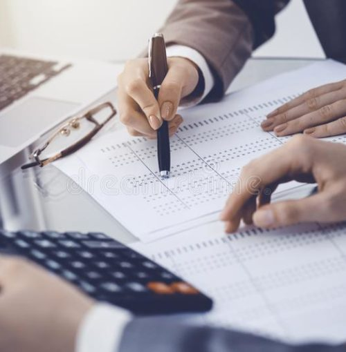 two-female-accountants-counting-calculator-income-tax-form-completion-hands-close-up-business-audit-concept-two-female-147374320